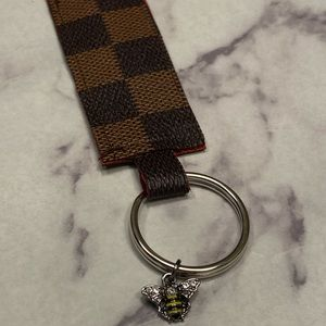 Louis Vuitton upcycled keychain with bee